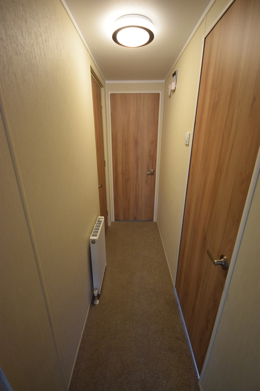 Sunrise Lodge II Mobile Home Annexe Hallway - sunrise holiday homes on home school designs, home mud room designs, home building designs, home wall designs, home conservatory designs, home study designs, home staircase designs, home floor designs, home garden designs, home walkway designs, home reception designs, home dining room designs, home beach designs, home front designs, home loft designs, home stairway designs, home great room designs, home entryway designs, home foyer designs, home glass designs,