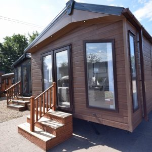 Exterior of Sunrise Lodge Abstract Log Cabin Annexe Garden Home